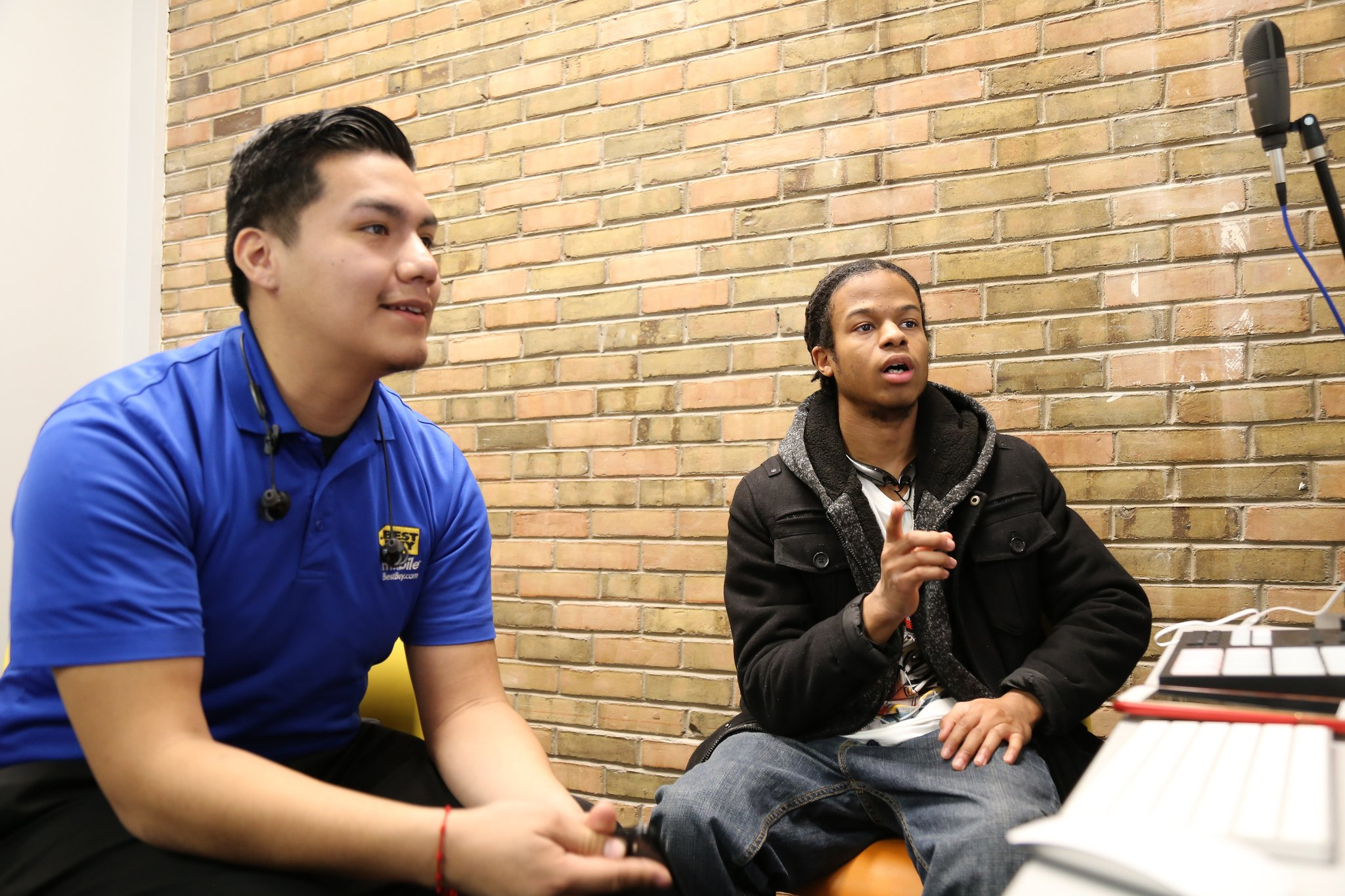 Two young men sit together at the Indianapolis Teen Tech Center