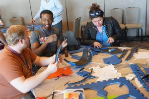 Conference attendees work on cosplay attire