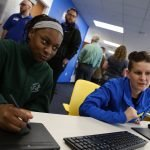 At the Hartford Best Buy Teen Tech Center Grand Opening, a youth and a mentor work together