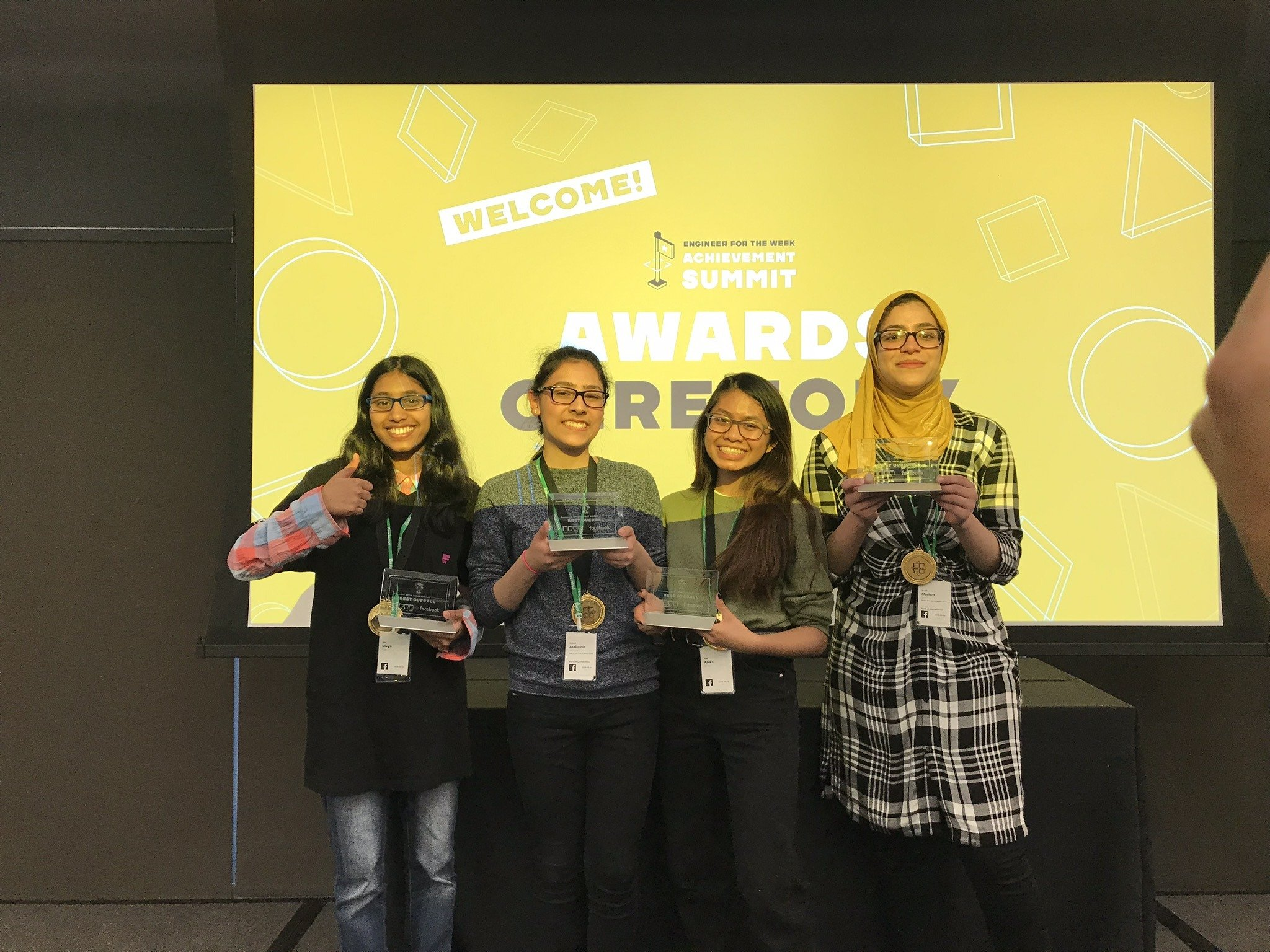 Members from The Best Buy Teen Tech Center @ Jersey City Boys & Girls Club accept the Best Overall Award at the Facebook Engineer for the Week Achievement Summit.
