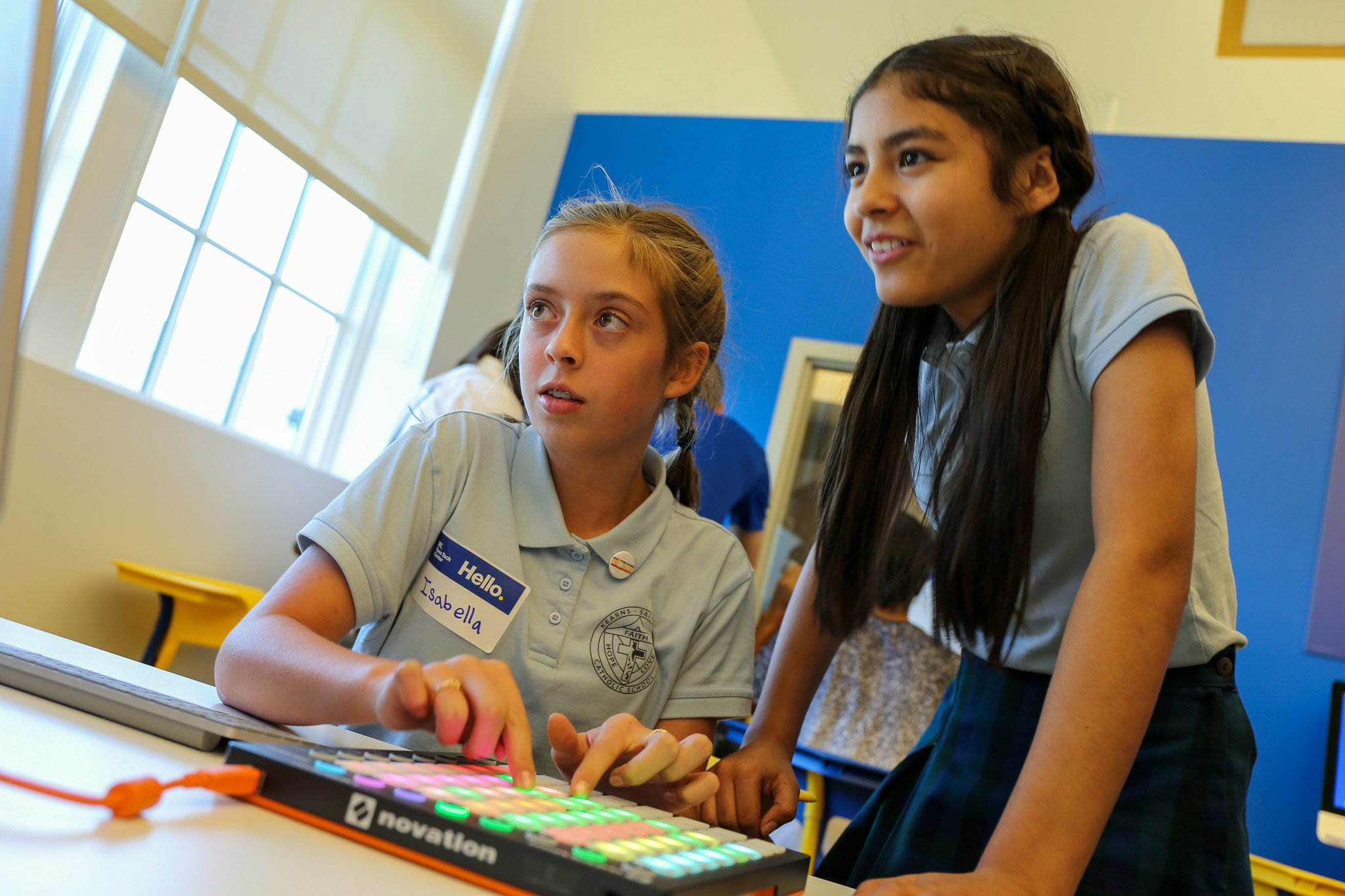 Banner: Two young women work with a MIDI pad controller