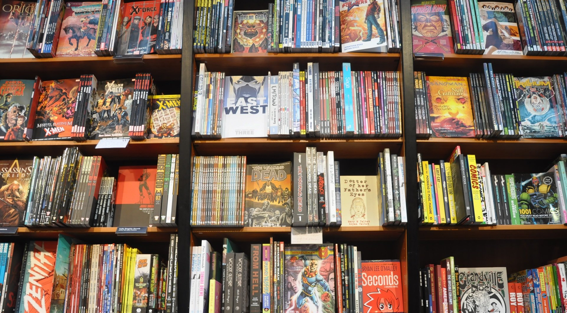 """Graphic Novels"" by flickr user morebyless is licensed under CC BY 2.0"